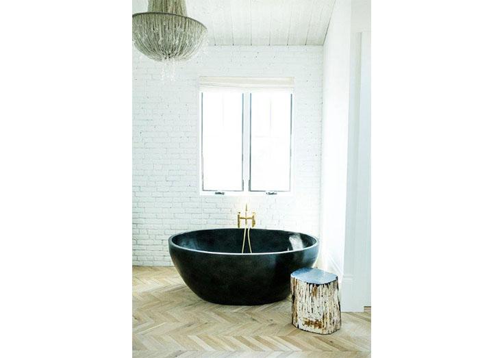 Modern bathtub in minimalist dark